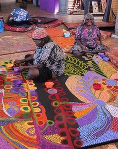 Traditional artists Wawiriya Burton (left) and Ruby Williamson. Artworks from South Australia's Tjala Arts range from traditional styles done in modern colours to more contemporary experimentations. Photo: Tjala Arts