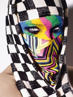 Nice eyes first. The colors and pattern contrast are dope. Rankin photography