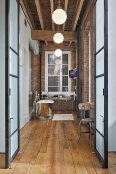 Love the big industrial frosted glass doors