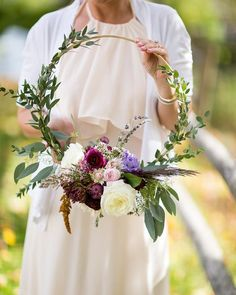 Swap your bridal bouquet for a floral hoop as a fun, alternative idea for your wedding flowers.