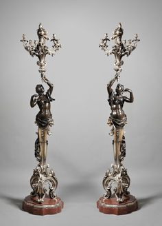 "Louis XV style pair of rouge marble, silvered and patinated bronze figural candelabra Ca1850-1899 France. 87.4""H."