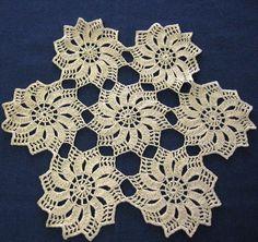 """Handmade Crocheted Ecru Pinwheel Design Doily Handmade Crocheted Ecru Pinwheel Design Doily    Measures 9"""" diameter    Crocheted with lightweight ecru cotton thread using a small crochet hook    Comprised of seven pinwheel motifs     Measures 9"""" diameter    Crocheted with lightweight ecru cotton thread using a small crochet hook    Comprised of seven pinwheel motifs"""
