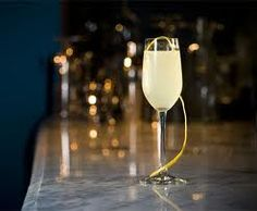 French 75 1 lemon 3 tablespoons ounces) gin 1 tablespoons ounce) fresh lemon juice 1 tablespoon ounce) simple syrup 1 cup ice cubes cup ounces) dry sparkling wine, such as brut Champagne, chilled French Cocktails, French 75 Cocktail, Champagne Cocktail, Sparkling Wine, Summer Cocktails, Cocktail Drinks, Cocktail Recipes, Alcoholic Drinks, Beverages