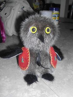 Inuit made sealskin owl by Florence Kataoyak