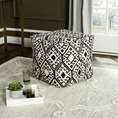 """With its dramatic juxtapositions, the pattern on this contemporary square pouf was designed to reflect the urban landscape of Barcelona. Its black and natural palette allows it to blend seamlessly into modern décor as a table, seating option or ottoman.  Color: Black and Natural Dimensions (W*D*H*): 18"""" x 18"""" x 18"""""""