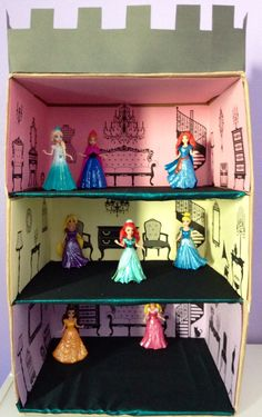 Castle for my daughters magic clip princesses. Made from a cardboard box, paper, fabric, and clip art of antique furniture. Easy to make and fin to play with. My cost $0!