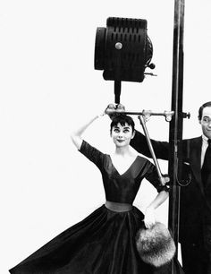 The actress Audrey Hepburn photographed with her fiancé Mel Ferrer (actor and director) by Richard Avedon at his studio in New York (USA), for a fashion editorial for Seventeen Magazine (edition of July 1954), on May 28, 1954.