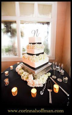 Wedding Cake With Orange Ribbon And White Flowers