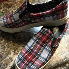 Steve Madden slip on shoes LIKE NEW! Super cute Steve Madden plaid slip on shoes. Hard to find. Size 7 but they fit a little too snug for my liking. Steve Madden Shoes