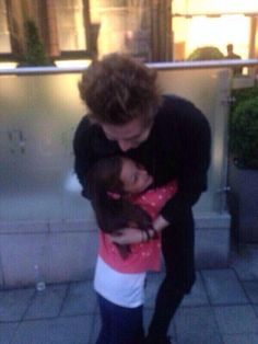 """Oh my gosh just imagine Luke coming home from tour and y'all's daughter runs up to him and wraps her tiny little arms around his torso and he hugs her back and she shouts """"Daddy! Daddy!"""" And he almost cried when he hugs her and you just stand there holding back tears and he whispers, """"I love you, sweetie,"""" before hugging and kissing you and why do I do this to myself"""