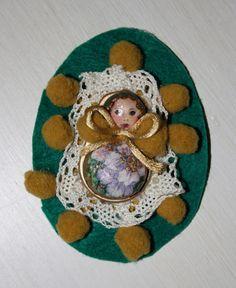 Babushka brooch made with ring tin.