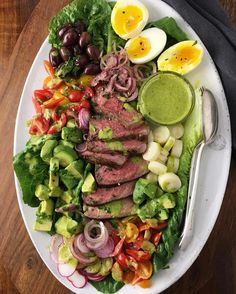 Always a big fan of #dinnersalads they're easy to pull together beautiful & great for feeding a crowd. This one by @nocrumbsleft features Steak Soft-Boiled Eggs Olives Tomatoes Hearts of Palm Avocado w/ a Coconut Mango Lime Cilantro Vinaigrette! Teri has become our go-to inspiration for what to serve at a dinner party & she has become a pillar of the #feedfeed community.When it came time to host our Chicago dinner with @AusterityWine Teri jumped in to help no questions asked. Our approach…