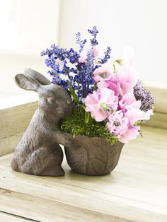 Fragrant lilacs, flouncy sweet peas, and delicate grape hyacinths are tucked into a Peter Rabbit-inspired planter. #Easter