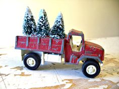 A Vintage Christmas- TootsieToy Red Deuce Truck, Vintage Christmas DecoR, With a Bed Full Of BottleBrush Trees. $8.00, via Etsy.