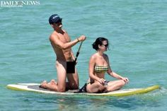 """Let's just hope Katy Perry made sure she lathered Orlando Bloom in sunscreen ... everywhere! The actor went """"Free Willy"""" as he stripped off his swimming trunks while paddleboarding with his girlfriend in the crystal clear waters of Sardinia, Italy."""