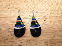 The Maasai intricate beadwork still amazes me. I like the teardrop shape of these earrings as well. Kinda cute... #africanart #africanfashion #africanjewelry #kenya #maasai...