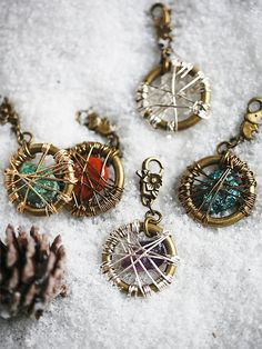 Dream Catcher Dog Tags | Brass dog tags featuring varying central stones that each offer unique healing and strengthening qualities. Lobster clasp closure for secure fit.