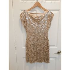 HP Gold sequin backless dress Lined, sequin embellished fabric  Boat neckline  Deep V back with tie straps Slim fit - cut closely to the body Hand wash Worn once for New Years As with most sequin dresses, this is prone to lose some sequins with each wear TFNC London Dresses Backless