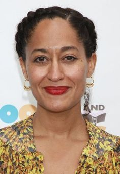 Tracee Ellis Ross beauty look. Love the bold red lip with minimal foundation. simple and elegant!