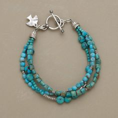From rounded to angular and blue to green, different shapes and shades of turquoise team up with Thai silver beads. The three-strand bracelet closes...