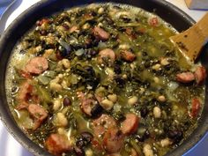 Swamp Soup! Ingredients: 2 large cans Old Glory seasoned turnip greens, 2 small cans black beans, 2 small cans navy beans, 2 cans chicken broth, 1/2 onion, minced garlic, 1 package Conecuh sausage.   Directions: chop onion, cut sausage into bite size pieces and brown on med heat.  Once browned add remaining ingredients and season to your liking.   Add a side of corn bread and enjoy!