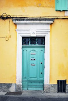 Pale yellow sided house with turquoise painted door for - Yellow and turquoise bathroom ...
