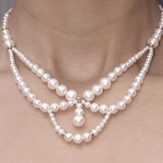 Renaisance inspired graduated draping pearl necklace with 14k yellow gold findings and clasp.