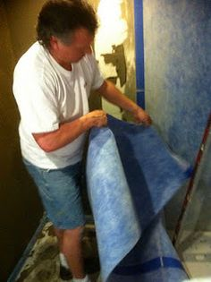 Installation of NobleSeal® TS CPE sheet membrane as primary waterproofing for a shower installation.