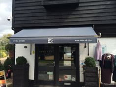 Even traditional Victorian shop blinds can look modern and contemporary with the right fabric and font style all carried out by Deans Blinds & Awnings