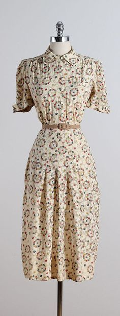 ➳ vintage 1940s dress  * cream semi sheer rayon * floral print * white button front * detachable tan belt * metal side zipper * by Franklin Fashions  condition | excellent  fits like large dress length 44 bodice 14 bust 46 waist 30 hips 36 shoulders 15.5 sleeves 10  ➳ shop http://www.etsy.com/shop/millstreetvintage?ref=si_shop  ➳ shop policies http://www.etsy.com/shop/millstreetvintage/policy  twitter | MillStVintage facebook | millstreetvintage instagram | millstreetvintage  5593/1608