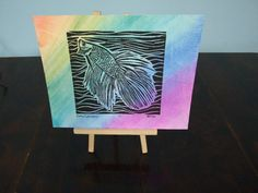 """This is the ultimate in limited run.  1 of 1 Rainbow Betta 11""""x 8.5"""" Watercolor Original Lino cut Print. This is a beautiful piece with calming colors and a fine net print in the background. This is the only one that has this coloring, the other printings are simple black and white so don't let this one pass you by. Very lovely piece."""