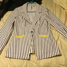 Jacket White and Black pinstriped jack with yellow cuffs and yellow pocket design. Worn twice. Kind of a thicker fabric but is very comfortable and can be worn in any weather condition. Tops