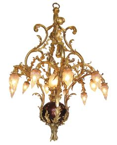 A Very Fine and Rare French Belle Epoque Century Nine-Light Gilt-Bronze Chandelier in the shape of a flower arrangement. The scrolled arms in the shape of tree-branches with tied-flowers and frosted-glass-flame shades, the center gilt-bronze sphe Chandelier For Sale, Bronze Chandelier, Chandelier Pendant Lights, Modern Chandelier, Crystal Chandeliers, Chandelier Centerpiece, Antique Lighting, Home And Deco, Frosted Glass