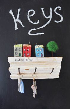 Use some pieces of scrap wood and nails to make this cute handy upcycled wall key holder. It would make a lovely gift as you can personalize it with your street name.