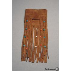 """Bag, c.1971, USA, Gift of Tony Santore, In Memory of Jack Fenstermacher. Collection of The Museum at FIT #TurnofStyle / Accessories of the free-spirited hippie era show a multitude of influences. As gender stereotypes broke down, men adopted """"far out"""" styles such as this fringed, beaded bag."""