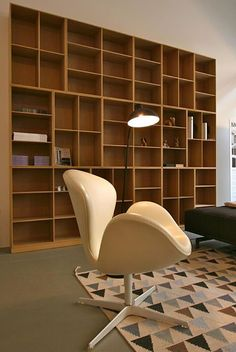 Mogens Koch bookcase from Carl Hansen, Mini Flag rug by Thomas Sandell from Asplund Kaiser idell lamp by Christian Dell and Swan Chair by Arne Jacobsen from Fritz Hansen