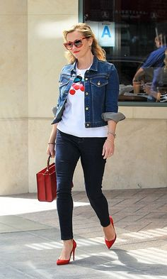Reese Witherspoon in a Graphic Tee, Skinny Jeans, Jean Jacket, and Red Pumps