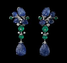 Indian Influences – High Jewelry Earrings Platinum, two pear-shaped carved sapphires totaling 25.24 carats, melon-cut emerald beads, cabochon-cut emeralds, sapphire carved leaves, brilliants.