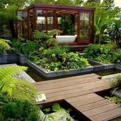 Outdoor bath., green house, raised beds