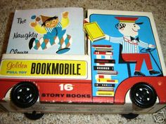 """A rare 1966 Golden Book bookmobile pull toy. This book box is in the form of a truck with four plastic wheels that move. There are 15 4""""x4"""" softcover books in the back of the truck."""