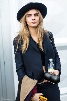 Cara leaving her hat on #offduty after Burberry. #CaraDelevingne #LFW