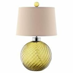 "With a textured glass base in a bright burst of green, this chic table lamp adds a touch of contemporary style to your decor. Product: Table lamp  Construction Material: Glass and fabric  Color: Green and ivory   Features: Hardback shade Coordinating finial3-Way switch Accommodates: (1) 100 Watt bulb - not includedDimensions: 24"" H x 15"" Diameter"