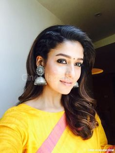 Nayanthara at the opening of Salem Kalyan Silks in a Yellow raw silk saree with contrast pink borders paired with 3/4 sleeves boat neck blouse