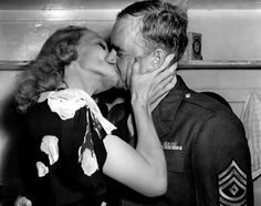 Marlene Dietrich making a soldier happy at the Hollywood Canteen