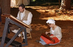 Jim McGaw plays the hammer dulcimer during the Under the Crown event in June at the Living History Park