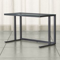 Shop Pilsen Graphite Glass Desk.   Designed by Mark Daniel, this piece offers versatile style against a wall or suspended in a room's center.  The Pilsen Graphite Glass Desk is a Crate and Barrel exclusive.