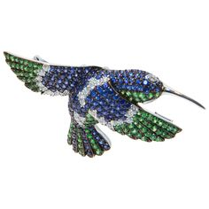 Exquisite Tsavorite Garnet Sapphire Diamond Hummingbird Brooch Pin | From a unique collection of vintage brooches at https://www.1stdibs.com/jewelry/brooches/brooches/