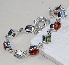 Amber ,Peridot Faceted bracelet designed and created by Sizzling Silver. Please visit  www.sizzlingsilver.com. Product code: BR- 8401