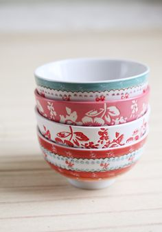 "Sweet Splendor Ceramic Bowl Set 32.99 at shopruche.com. This set of four colorful hand painted ceramic bowls are completed with charming floral designs and whimsical stripes, perfect for mixing and matching.4.5"" Wide, 2.75 Tall, Microwavable and dishwasher safe"