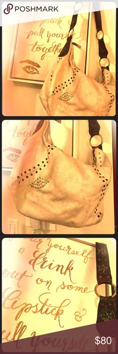 Betsey Johnson Shoulder Betsey Johnson Shoulder Bag in white/gold studs w/brown shoulder band. The pictures make the bag look golden/cream, but actually white. Good condition, worn, but a big fashion statement. Betsey Johnson Bags Shoulder Bags